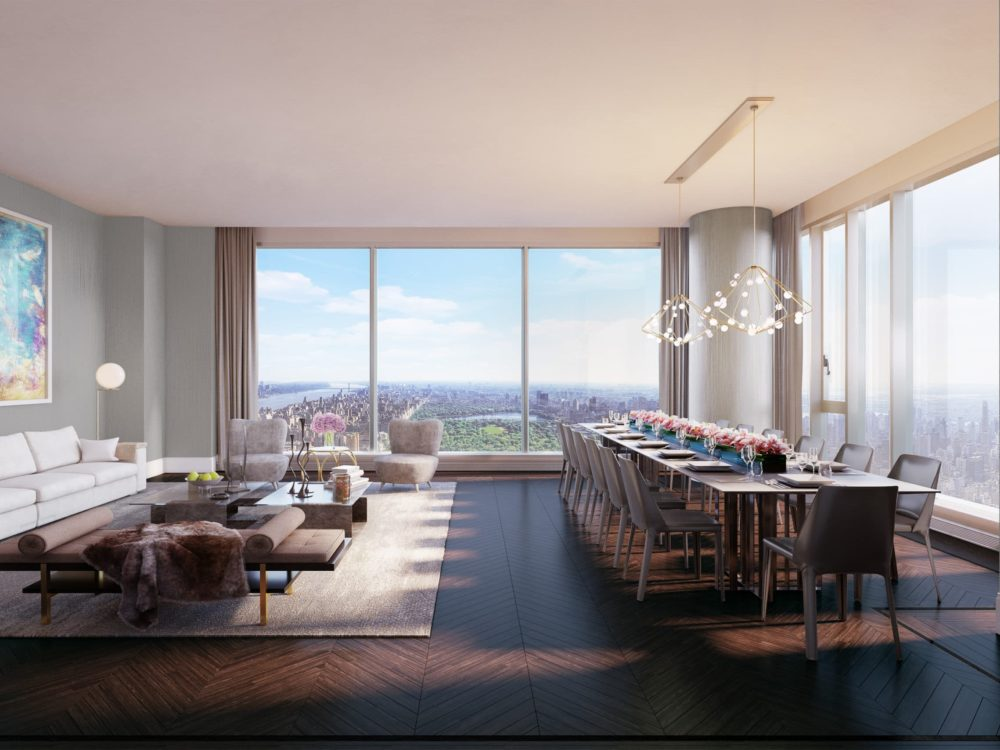 Interior view of Central Park Tower residence grand salon with skyline view of NYC. Has wooden floors and lounge chairs.