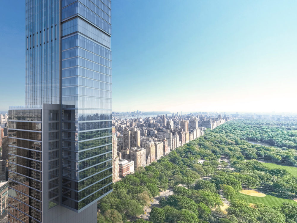 Exterior mid view of Central Park Tower condominiums in New York City and Central Park in the background.