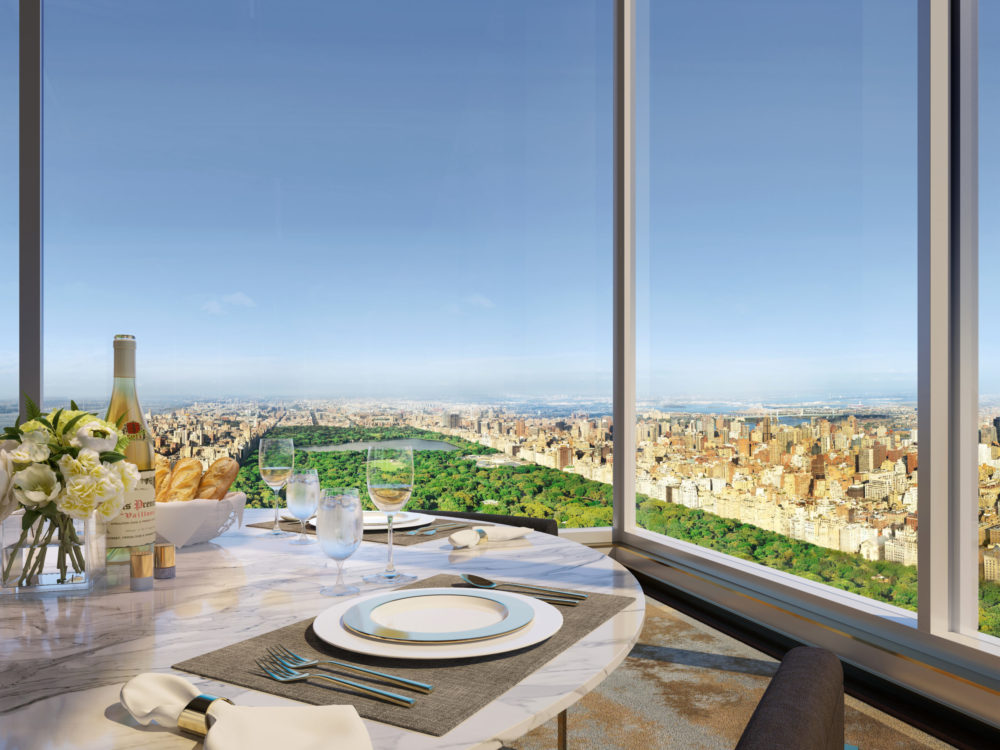 Exterior view of Central Park Tower residence terrace dining with skyline view of NYC and Central Park.