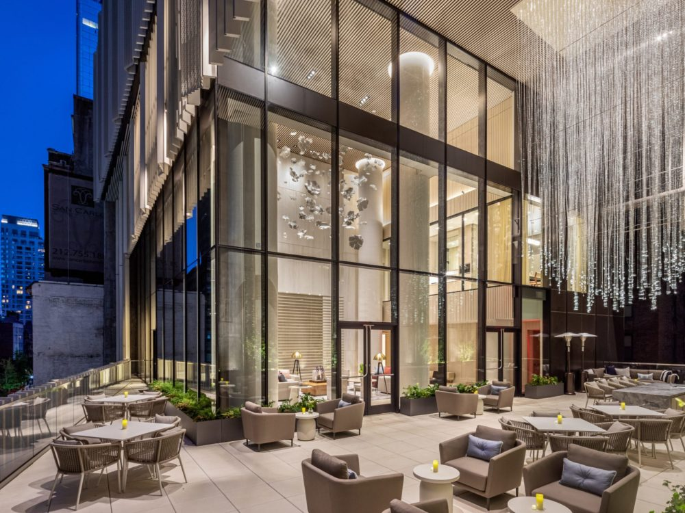 Residents only terrace at The Centrale condominiums in New York. Outdoor terrace with ample seating and city views.