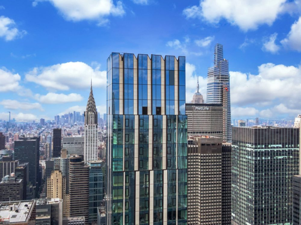 Exterior view of The Centrale penthouse in New York. Residential tower with Manhattan skyline in the background.
