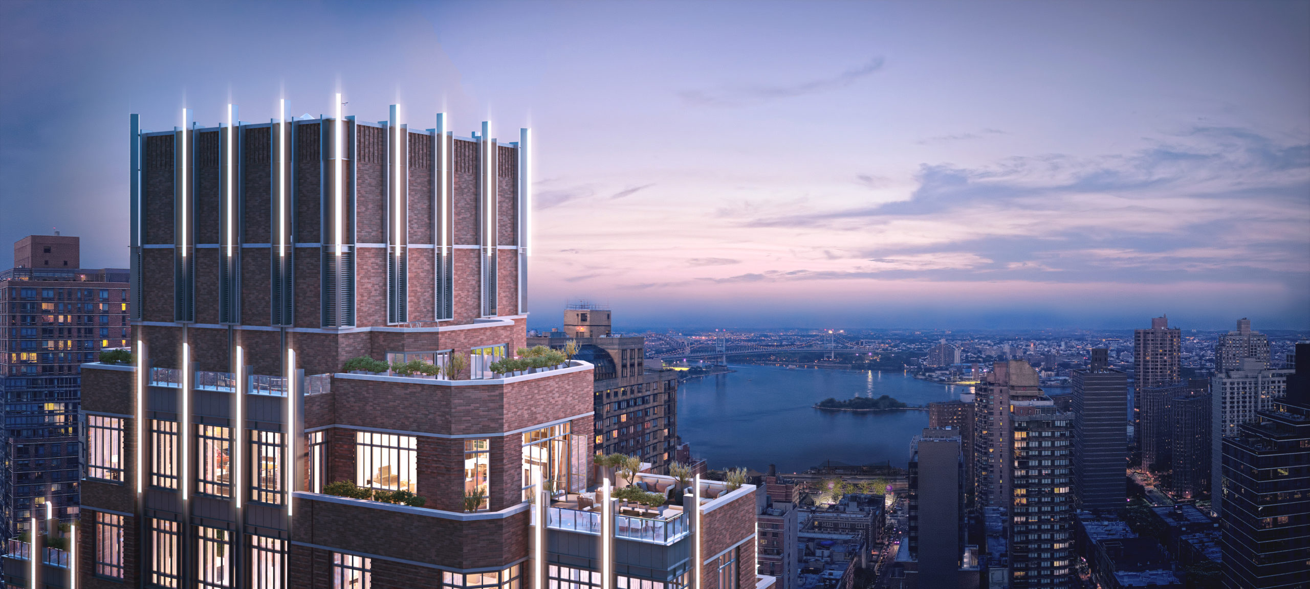 Birdseye view of the Kent penthouse in New York City. Brick exterior with rooftop patio with unobstructed city views at dusk.