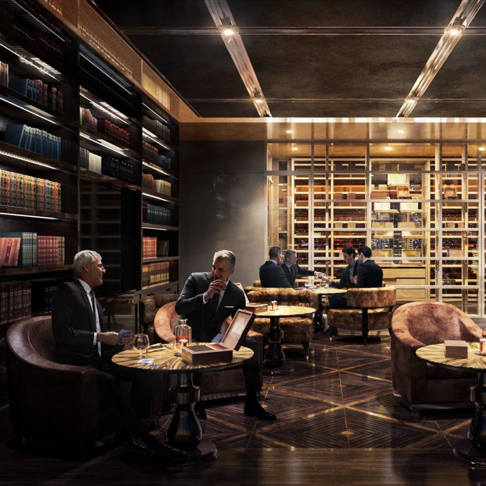 Interior view of Central Park Tower residence cigar club with skyline view of NYC. Has dark ambiance with leather seating.