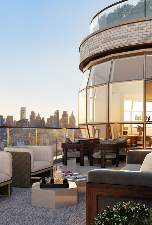 Exterior view of Lantern House residence terrace in NYC. Has lounging furniture with a fireplace in the middle.