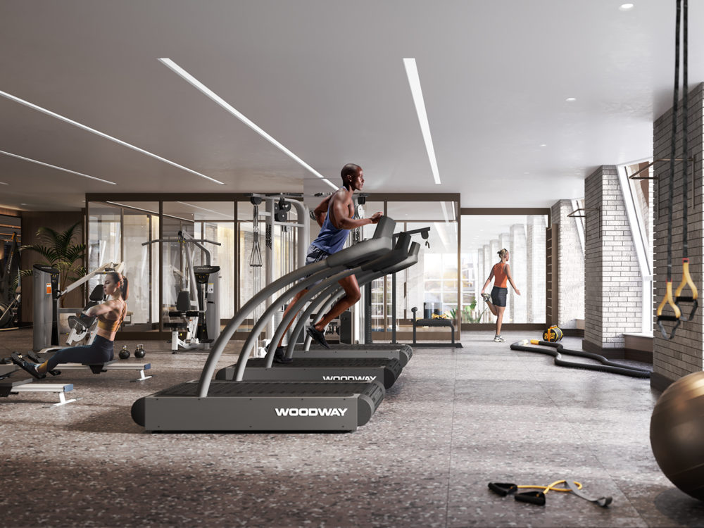 Interior view of Lantern House residence fitness center with skyline view of NYC. Has cardio and stretching equipment.