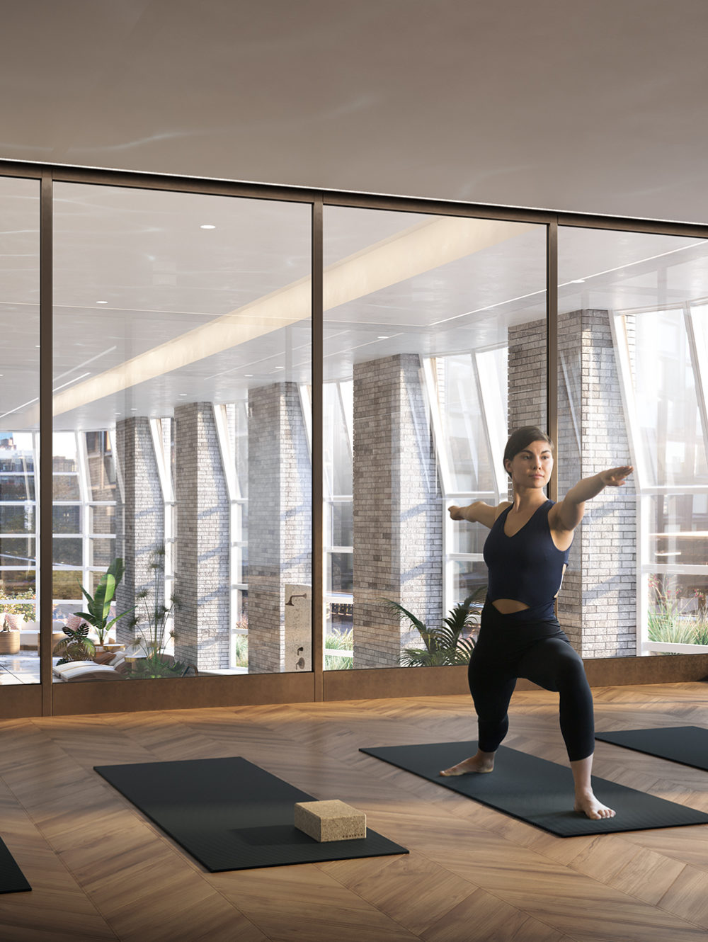 Interior view of Lantern House residence yoga room with window view of NYC. Has yoga mats and wooden platform.