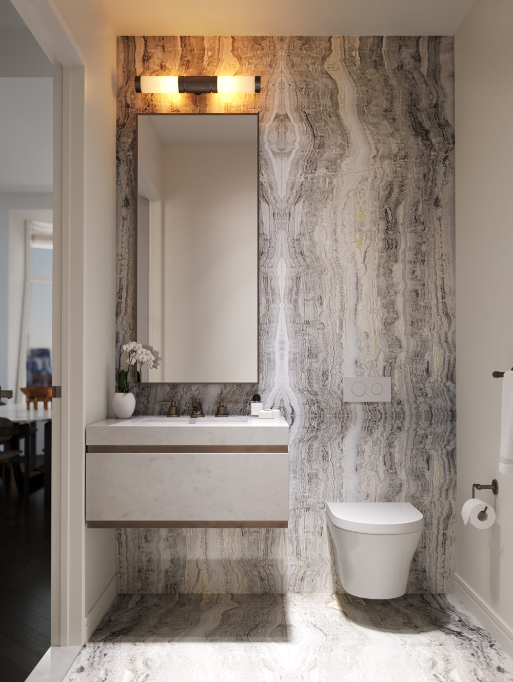 Interior view of Lantern House residence powder room in NYC. Has marble walls, a sink and mirror set and a toilet.