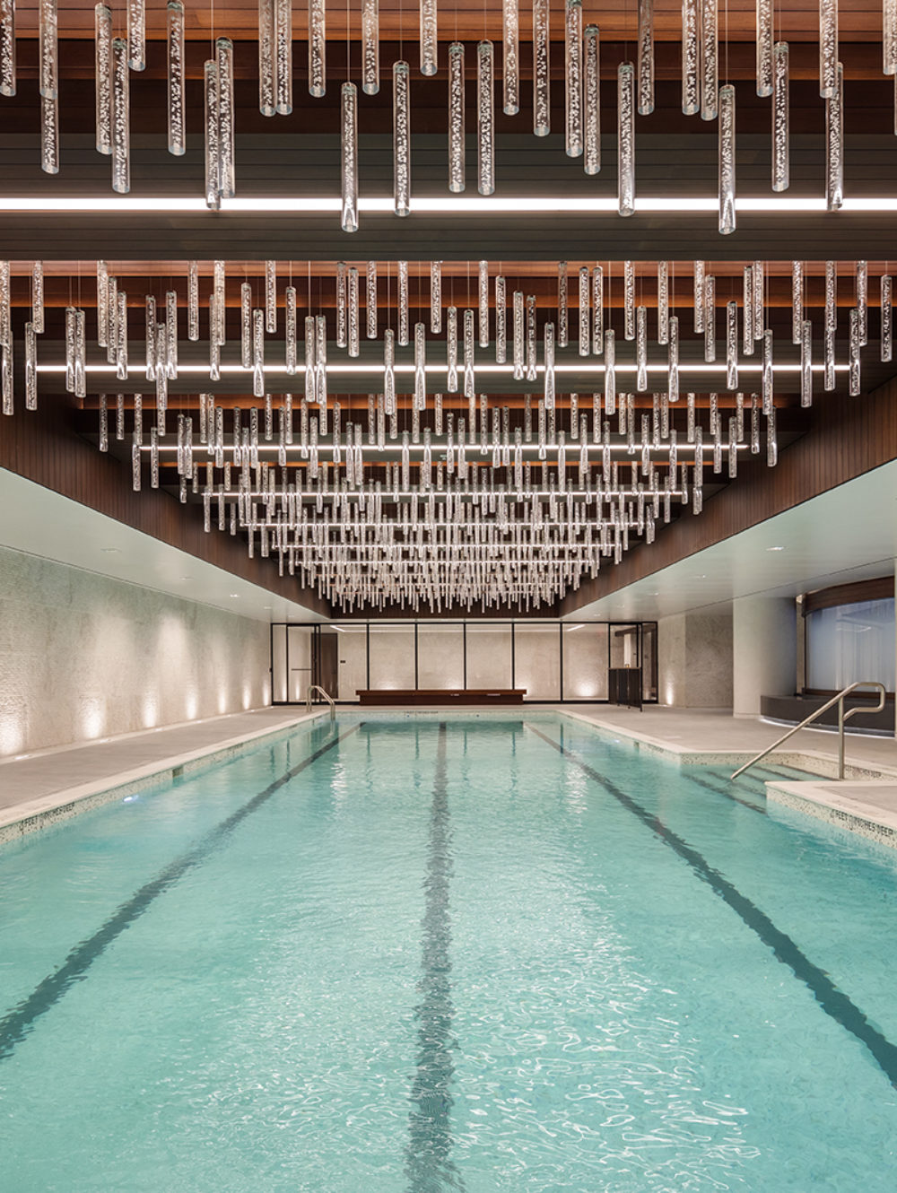 Indoor pool at One Manhattan Square luxury condominiums in NYC. Four lane lap pool with sauna and sitting area.