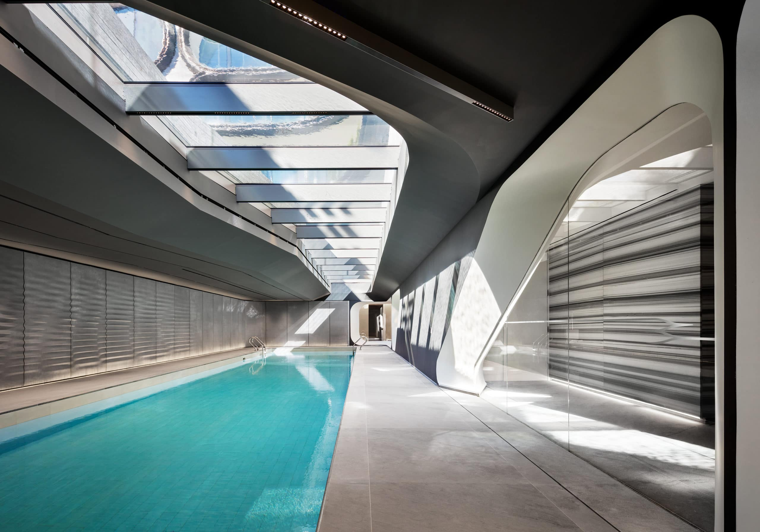 75-foot saline swimming pool at 520 W 28 condominiums is illuminated by a series of skylights in New York City.