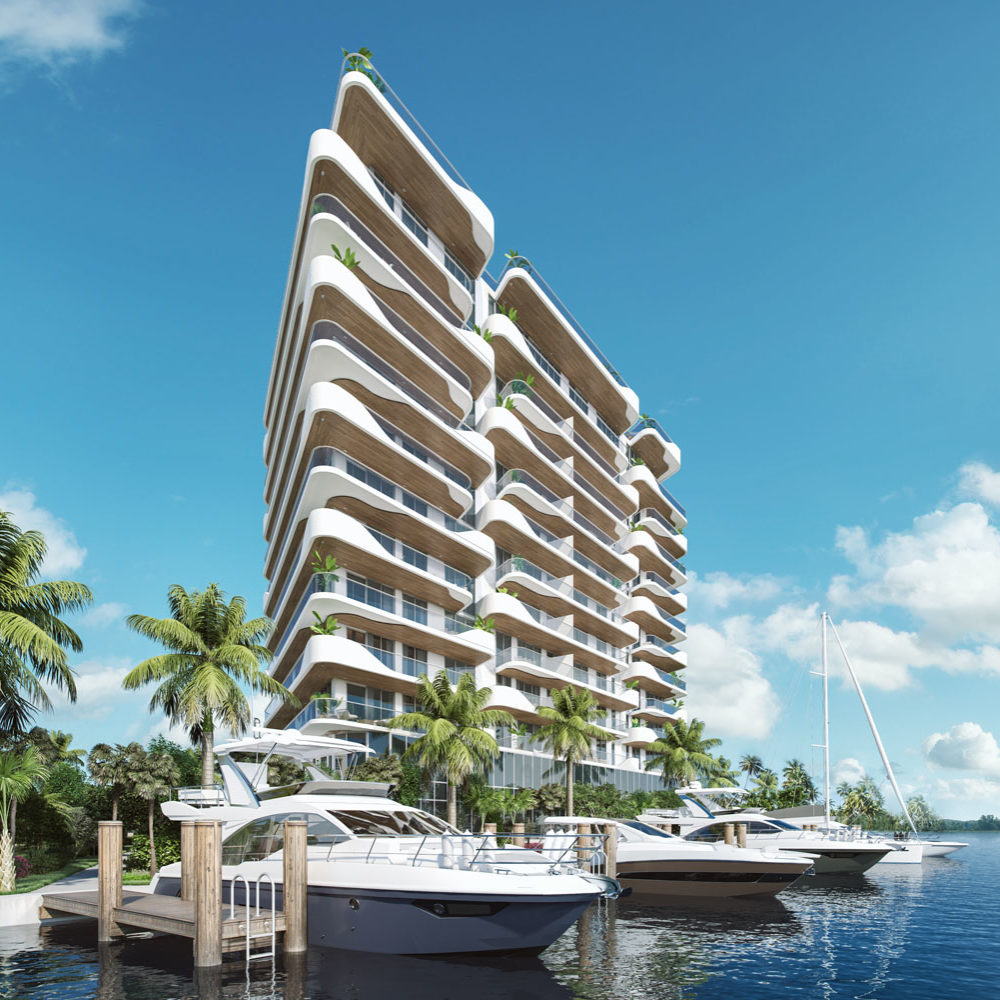 View of Monaco Yacht Club luxury residences in Miami taken from the docks with boats and palm trees in the forefront.