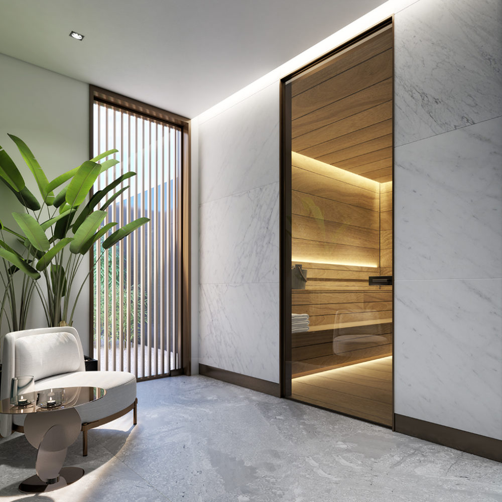 Interior of sauna room inside 2000 Ocean condominiums in Miami. Includes white walls, white floors, and decorative plants.