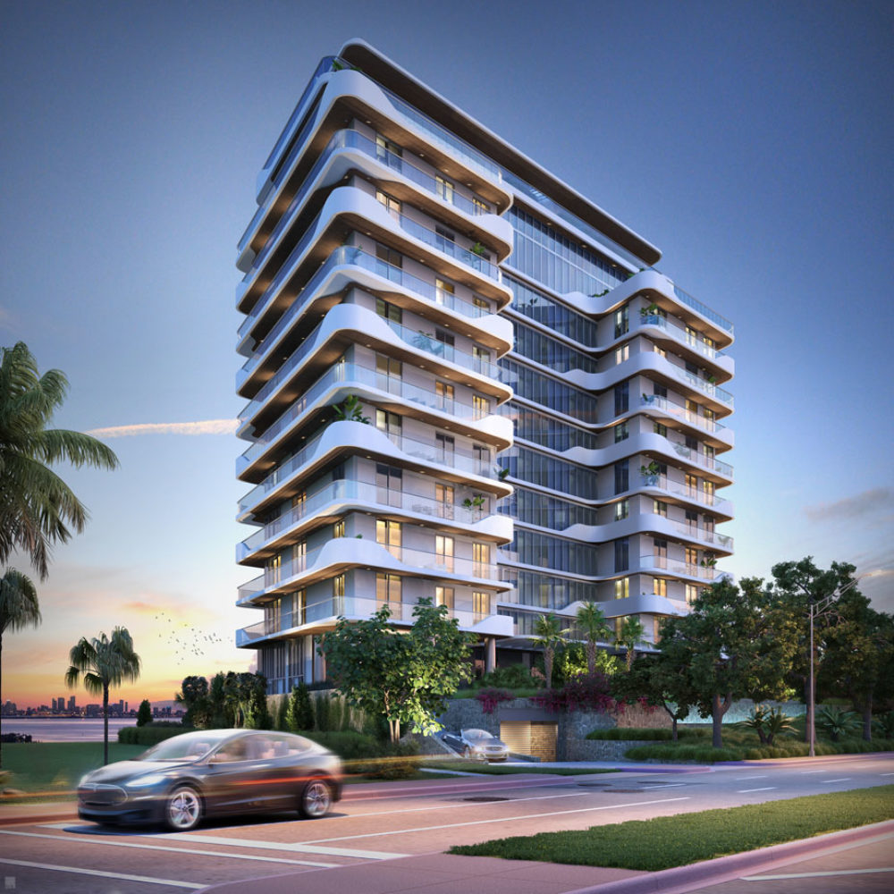 Exterior view of Monaco Yacht Club residence building in the clear blue Miami skies. Has oceanfront view.