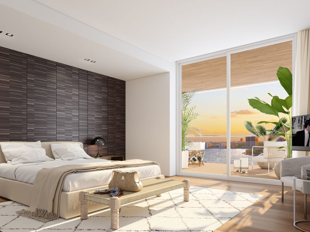 Interior view of Monaco Yacht Club residence bedroom with window view of the ocean. Has wood floors and bed in the center.