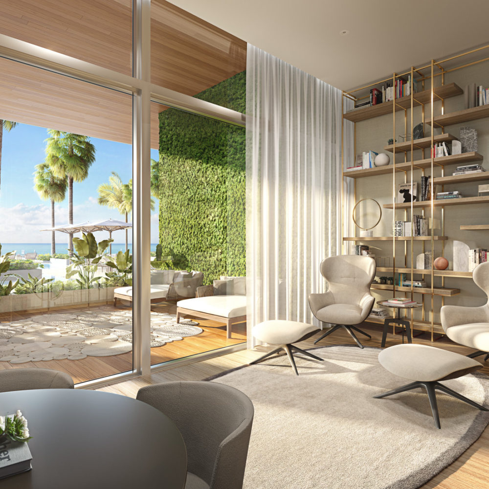 Interior view of 57 Ocean residence library and balcony in Miami. Has shelves, longue chairs and wood floors.
