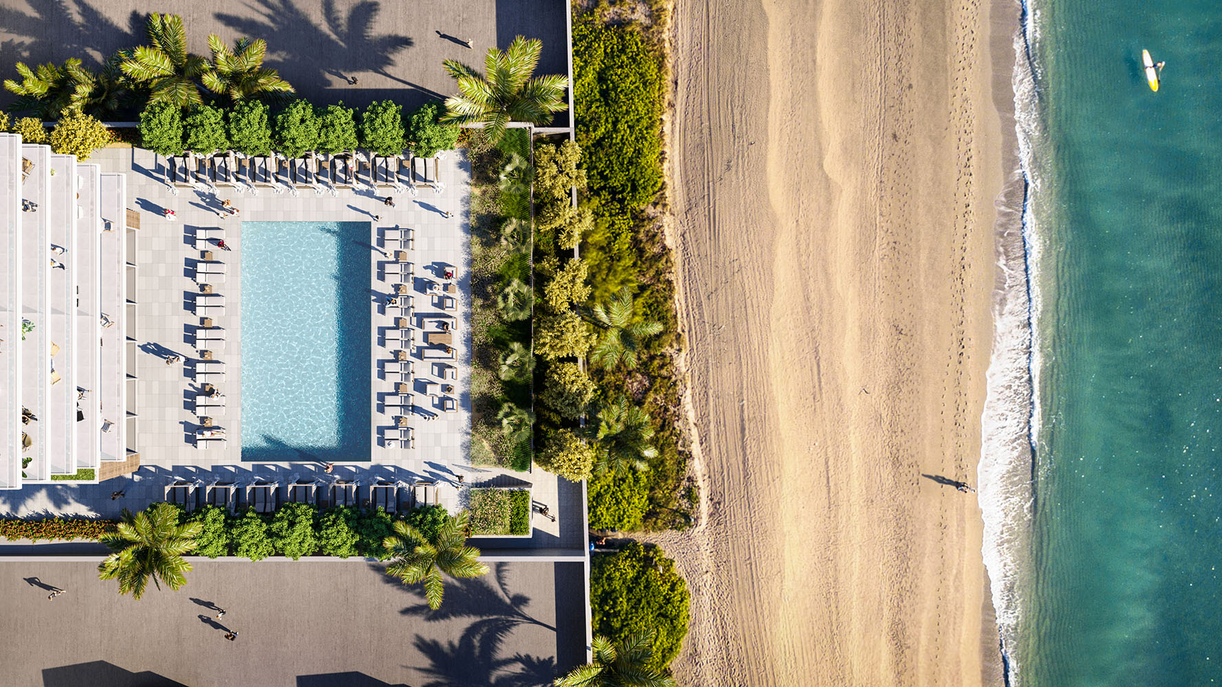 Exterior aerial view of 2000 Ocean condominium with an ocean front pool with palm trees located in Hallandale Beach, Florida.