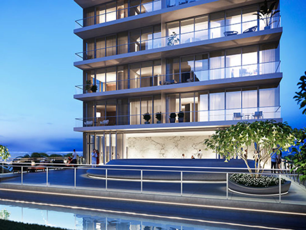 Exterior aerial view of 2000 Ocean condominium with a view podium deck and pool located in Hallandale Beach, Florida.