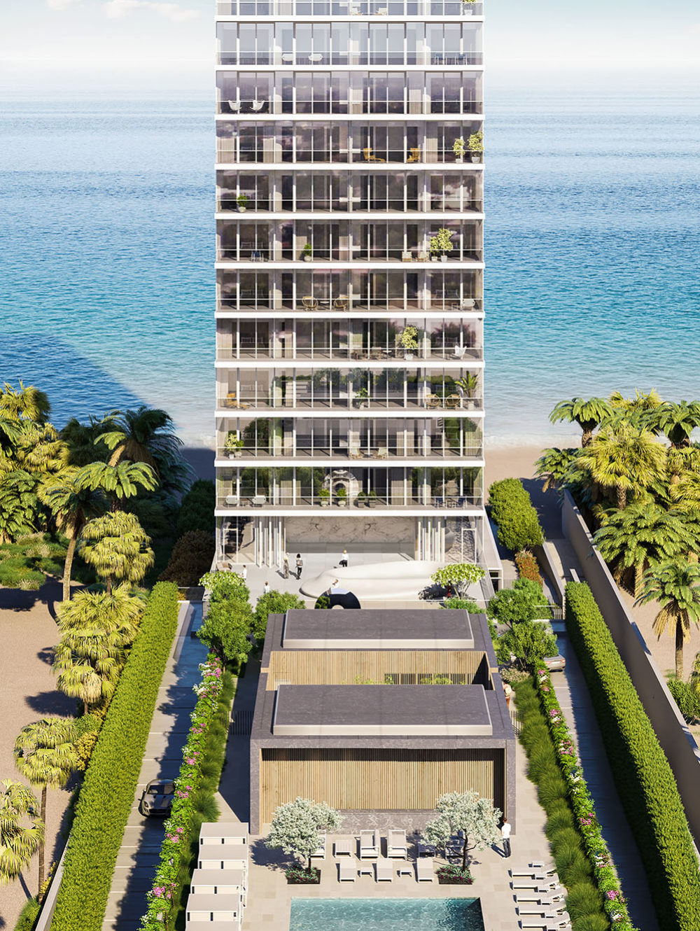Exterior aerial view of 2000 Ocean condominium with a view of the ocean and pool located in Hallandale Beach, Florida.