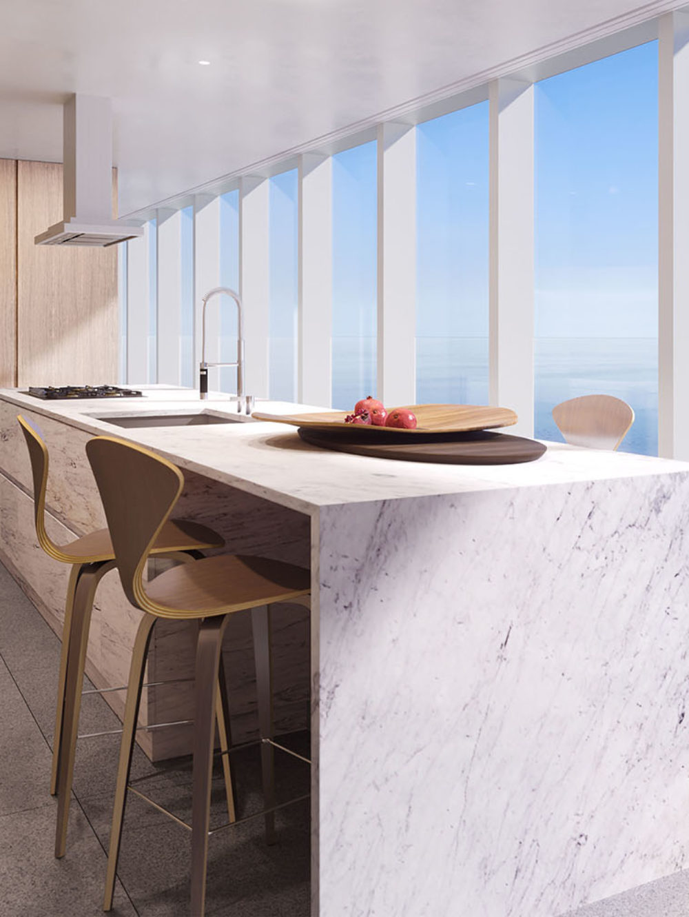 Interior view of 2000 Ocean residence kitchen located in Miami. Includes window view of the ocean and white furniture.