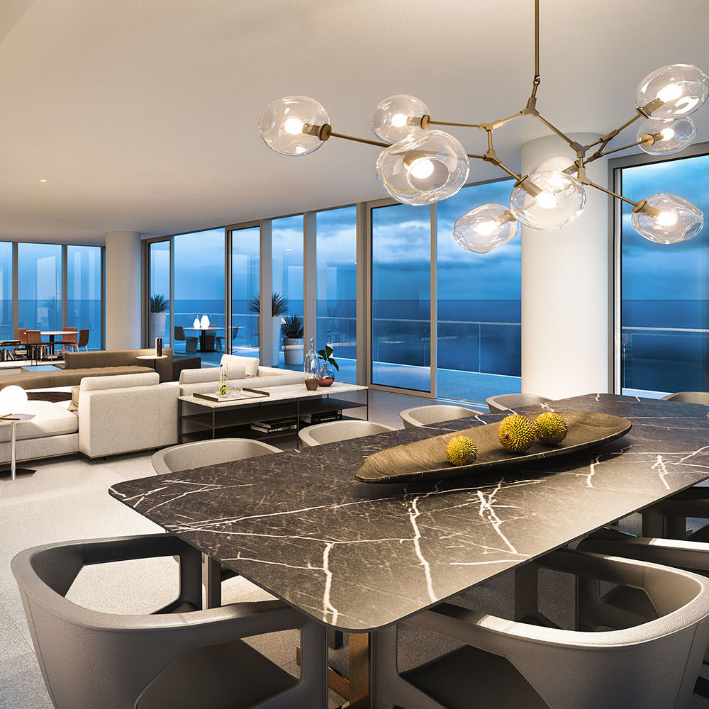 Interior view of living room and dining room inside 2000 Ocean condominiums with window view of ocean in Miami.