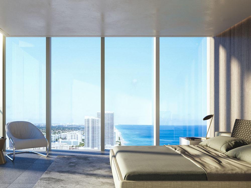 Interior view of master bedroom inside 2000 Ocean condominiums with window view of ocean located in Miami.