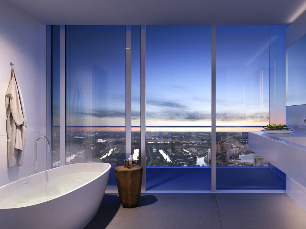 Interior view of residence bathroom inside 2000 Ocean condominiums with window view of Hallandale Beach, Florida.
