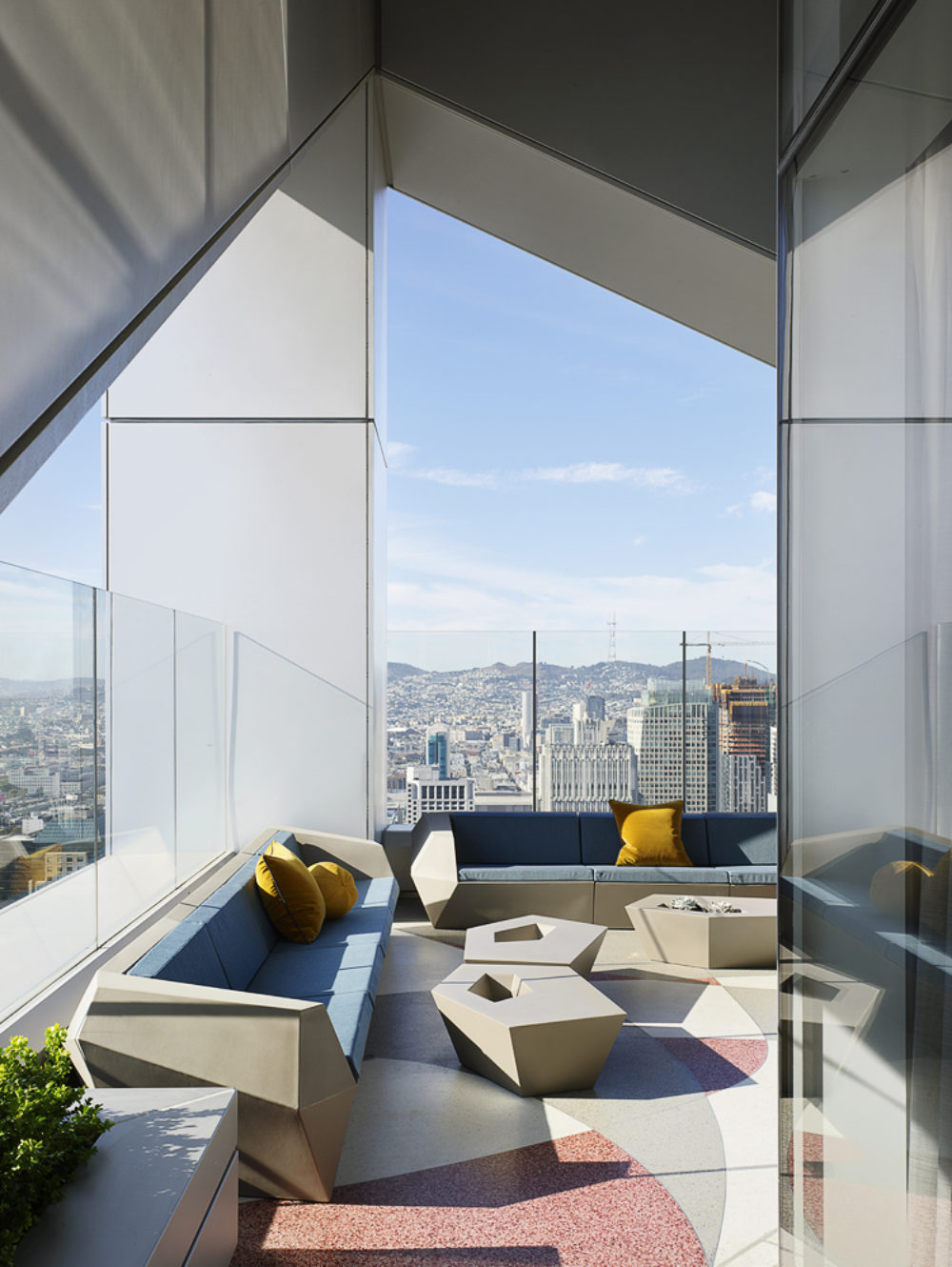 Exterior view of top floor balcony at 181 Fremont condominiums with a skyline view of San Francisco in the daytime.
