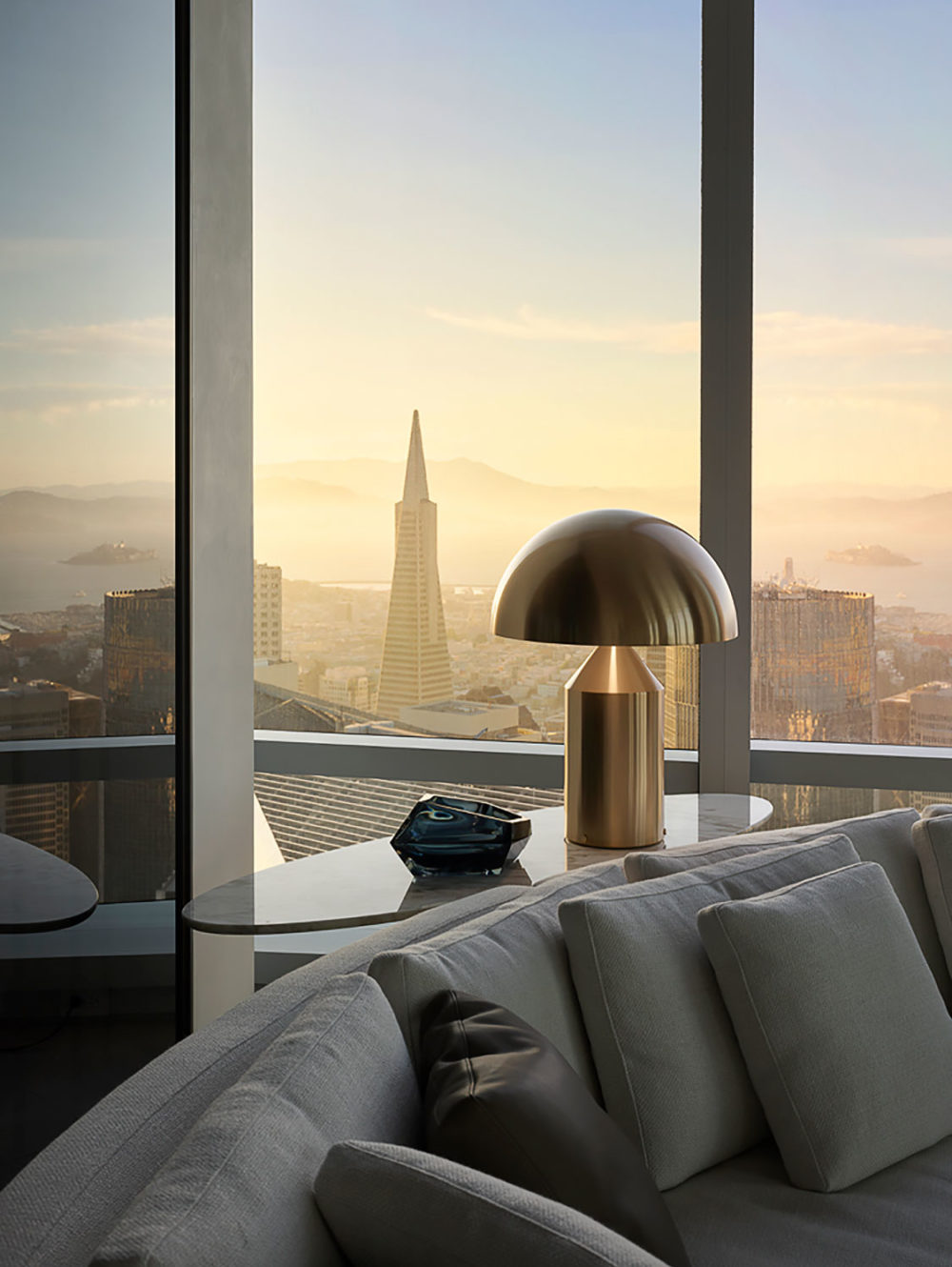 Closeup interior view of residential living room inside 181 Fremont with a view of San Francisco during the sunrise.