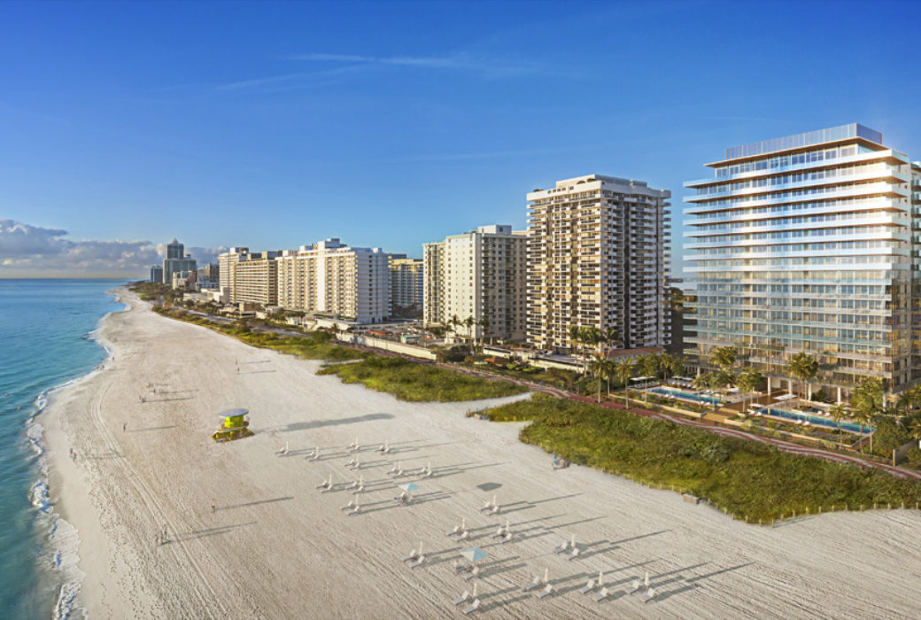 Exterior aerial view of 57 Ocean condominiums in Miami. Has view of beachfront and surrounding buildings.