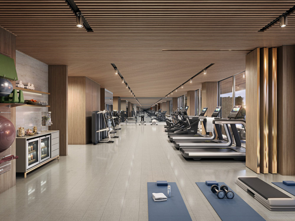 Interior view of 57 Ocean residence gym in Miami. Has cardio equipment, yoga mats and smooth floors.