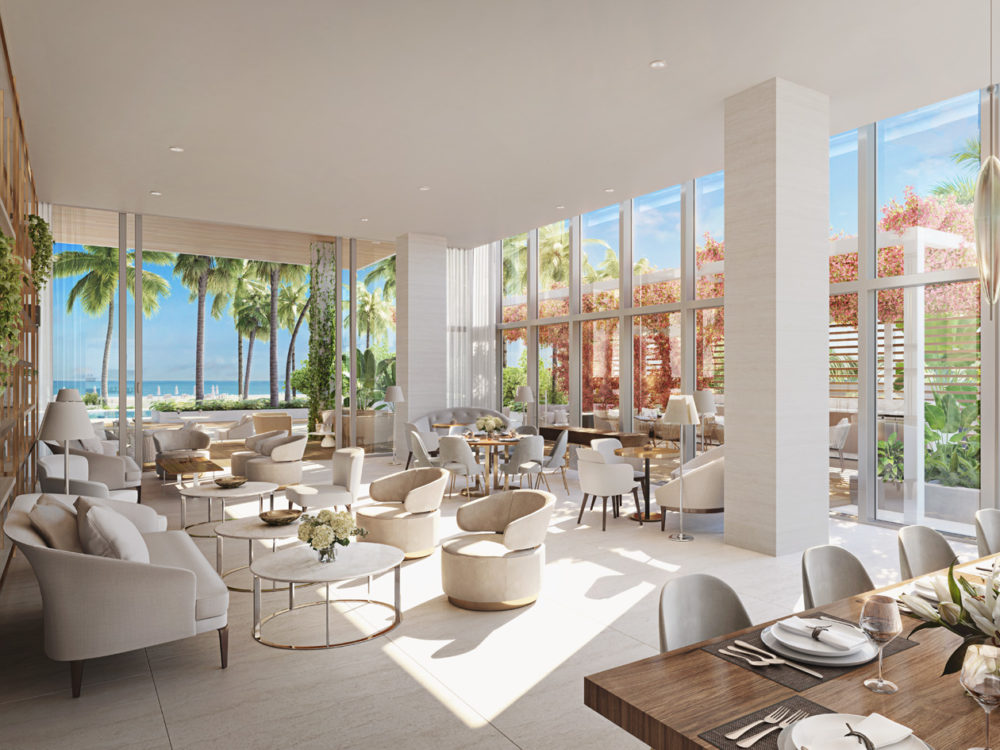 Interior view of 57 Ocean residence party room in Miami. Has open dining area, white floors and white walls.