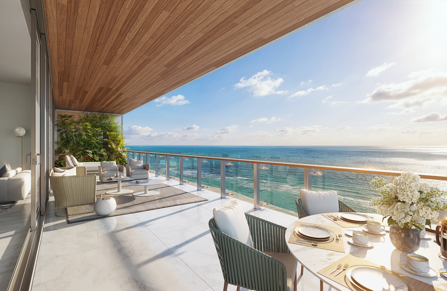 Exterior view of 57 Ocean residence balcony with ocean view in Miami. Has wood ceiling, white floors and coffee table.