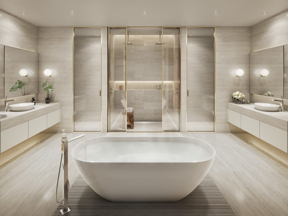 Interior view of 57 Ocean residence master bathroom in Miami. Has white tile flooring, white walls and white counters.