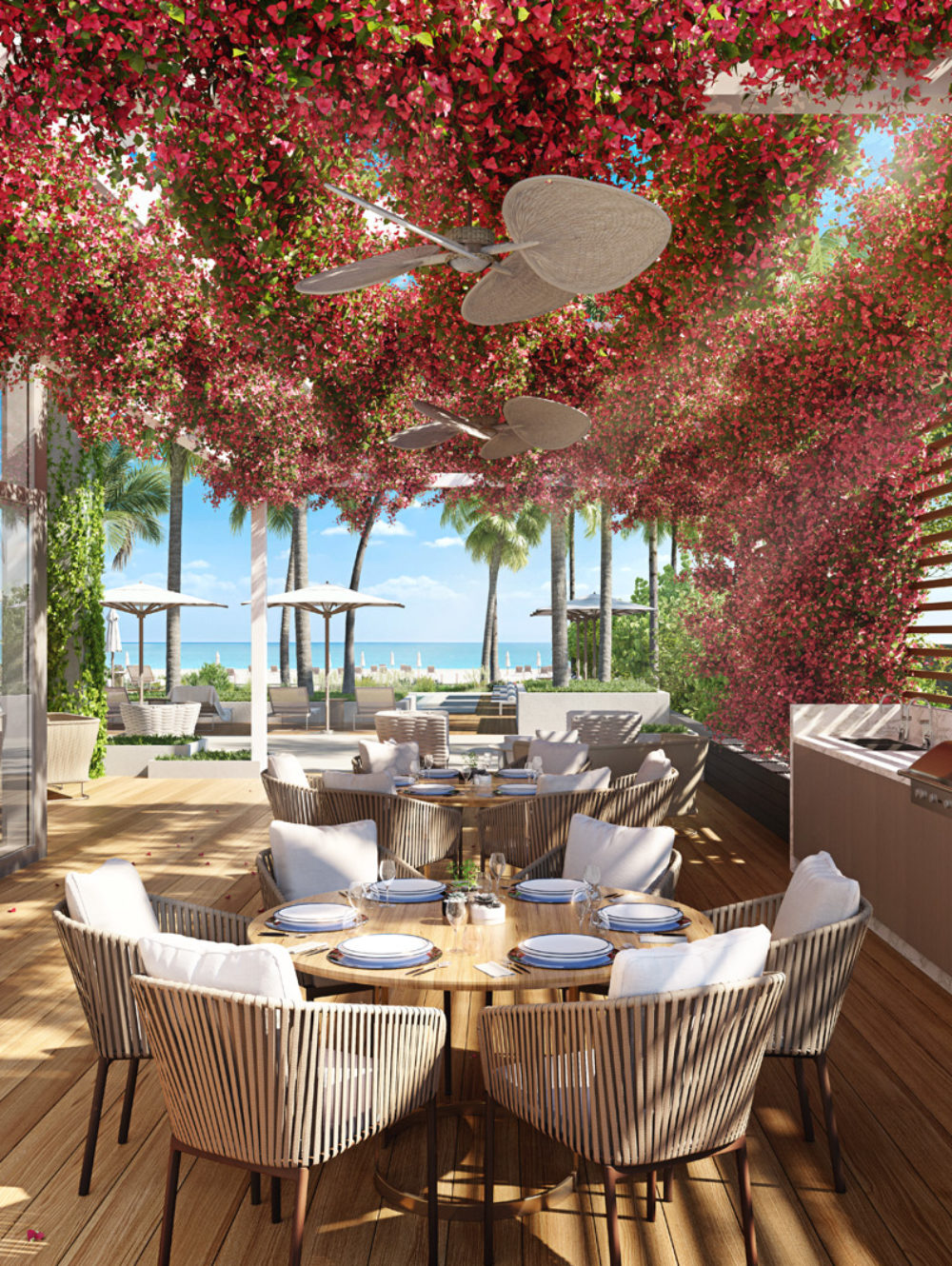 Exterior view of 57 Ocean residence terrace and grill area in Miami. Has a floral ceiling, dining areas and wooden floors.