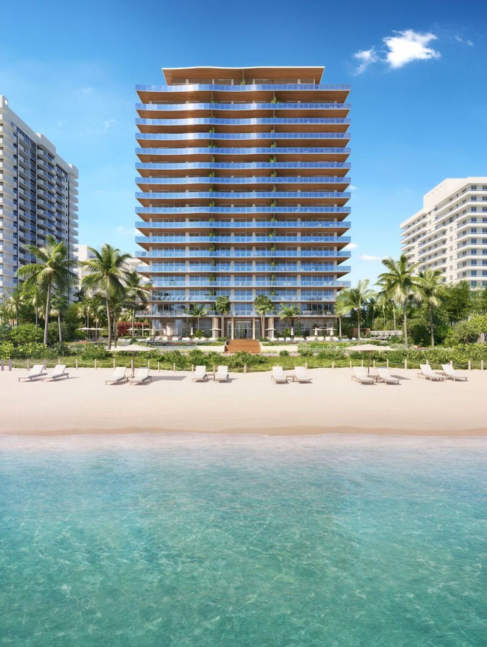 Exterior zoomed out view of 57 Ocean condominiums in Miami. Has view of oceanfront, palm trees and blue sky.