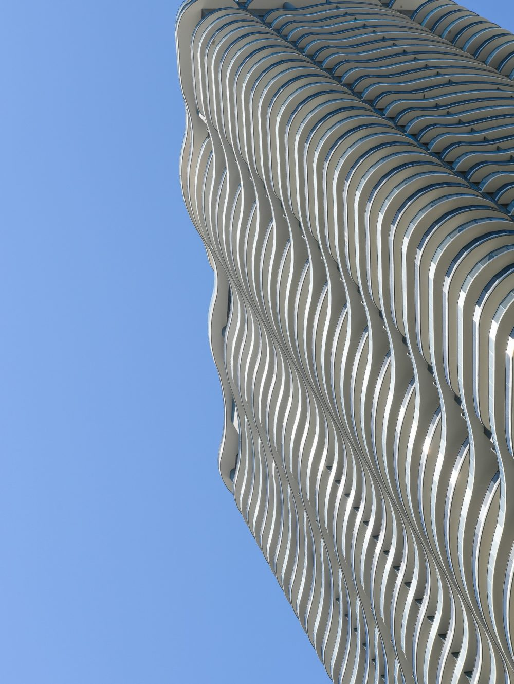 Exterior scale view of Brickell Flatiron condominiums detailed architecture. Has Biscayne Bay and downtown Miami views.