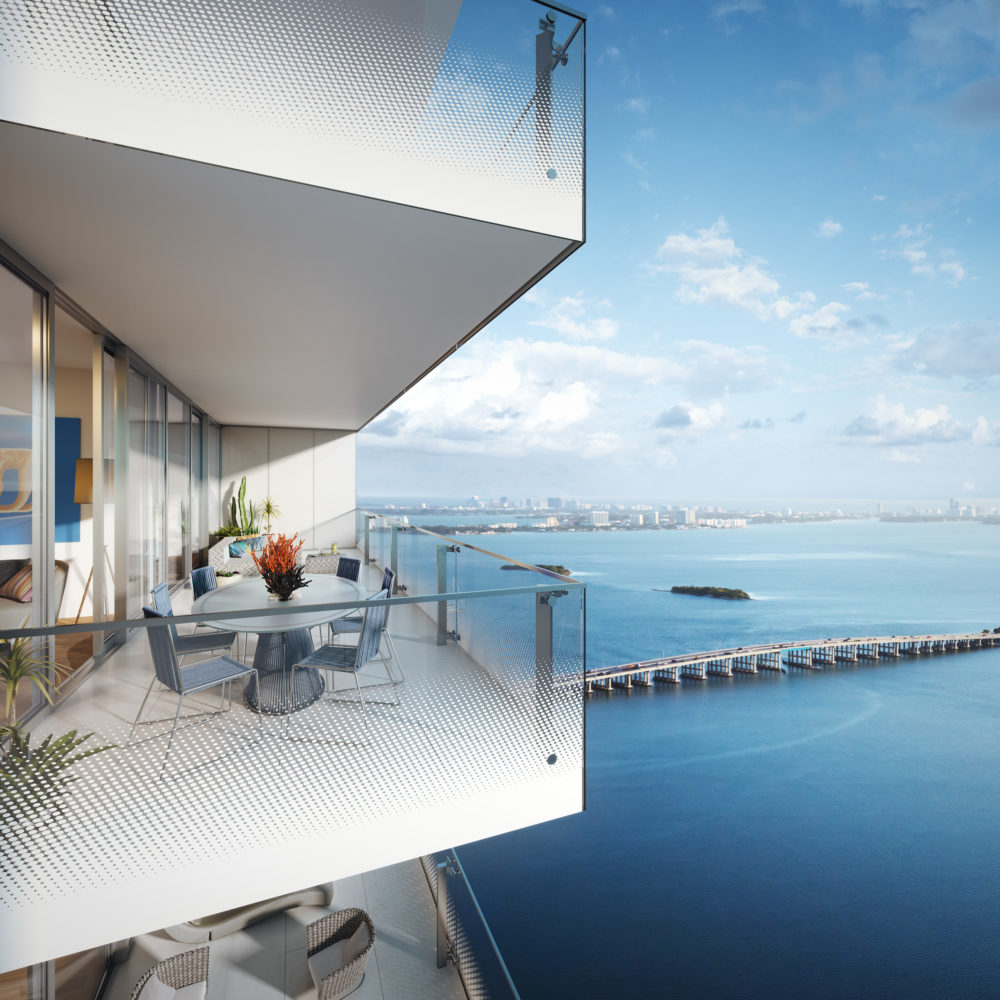 Birds eye view of Missoni Baia luxury condo balcony in Miami overlooking Biscayne Bay during the day with clear skies.
