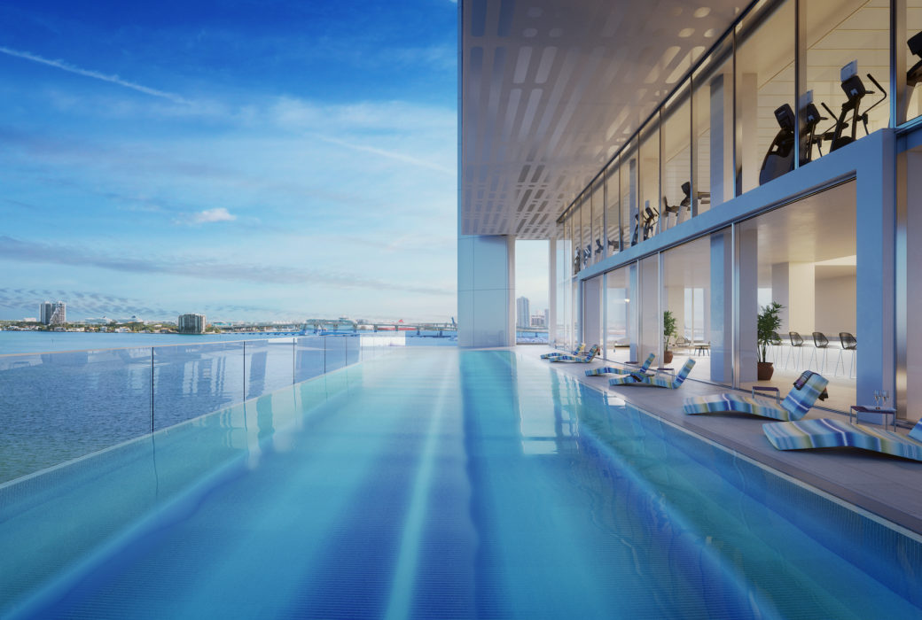 Exterior view of terrace infinity pool at Missoni Baia townhouse with oceanfront and Biscayne Bay views.