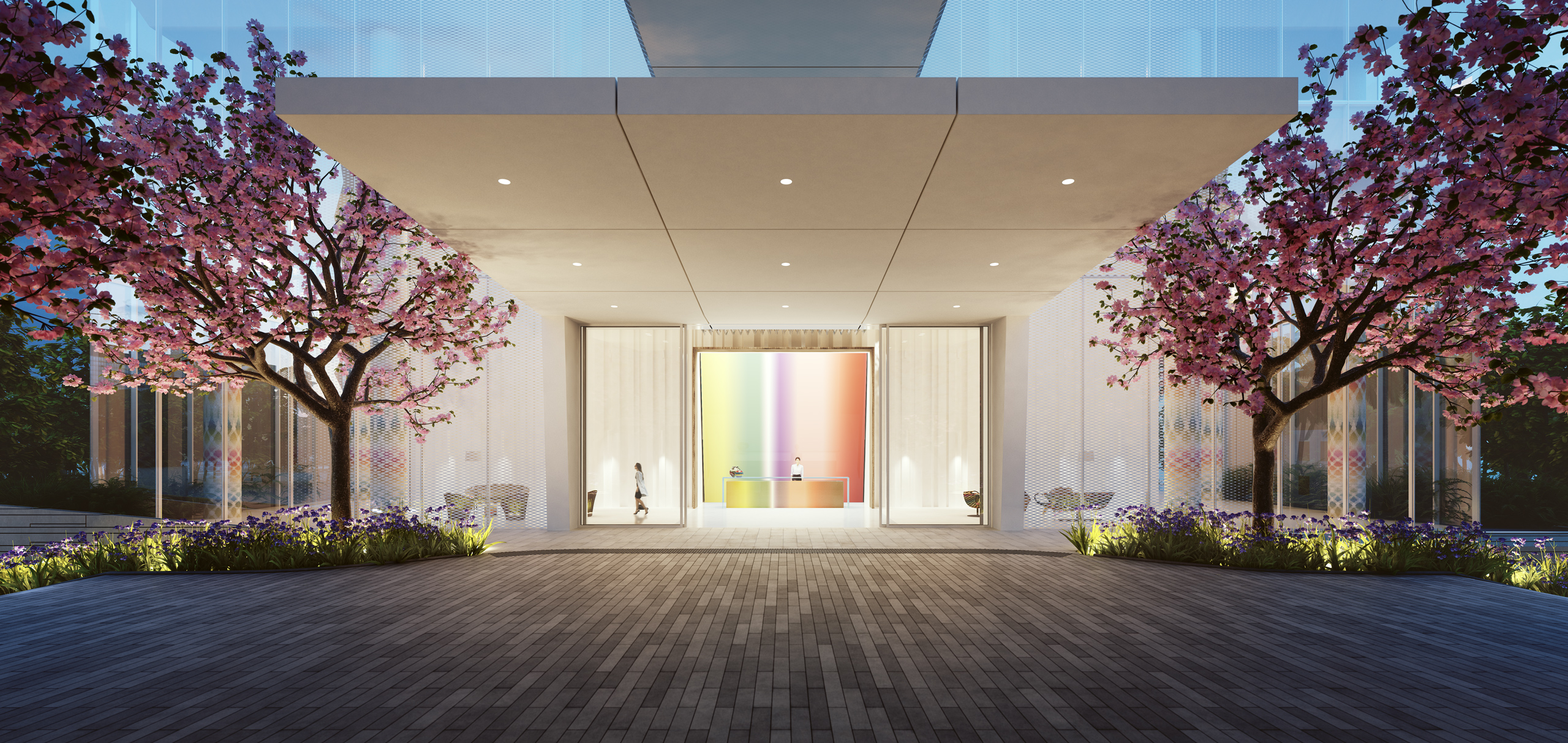 Exterior view of entrance to Missoni Baia condominiums with red trees lining the walkway. Includes Miami oceanfront view.