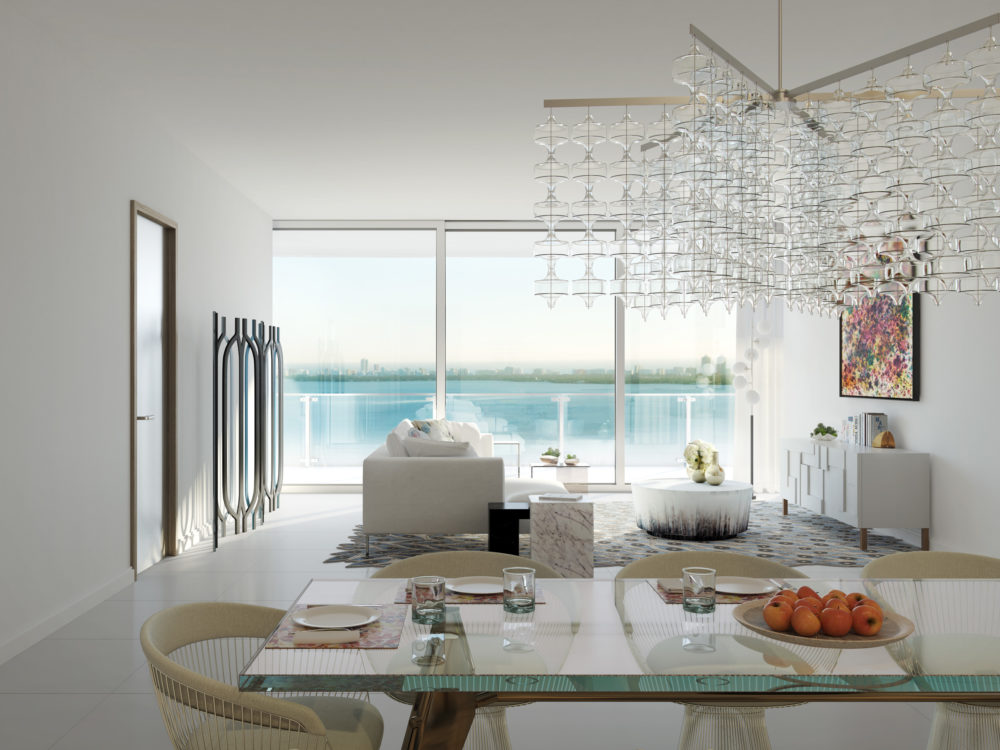 Interior view of Missoni Baia residence living room with clear windows with oceanfront view. Has glossy floors and furniture.