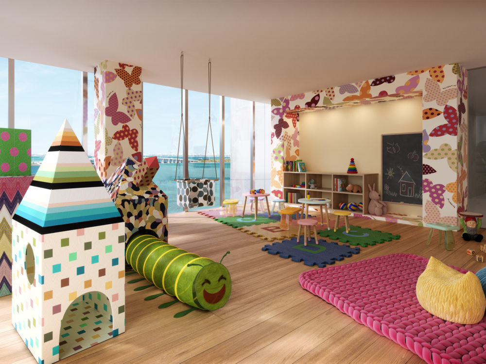 Interior view of Missoni Baia residence children's playroom. Has wooden floors, play areas and window view of the ocean.