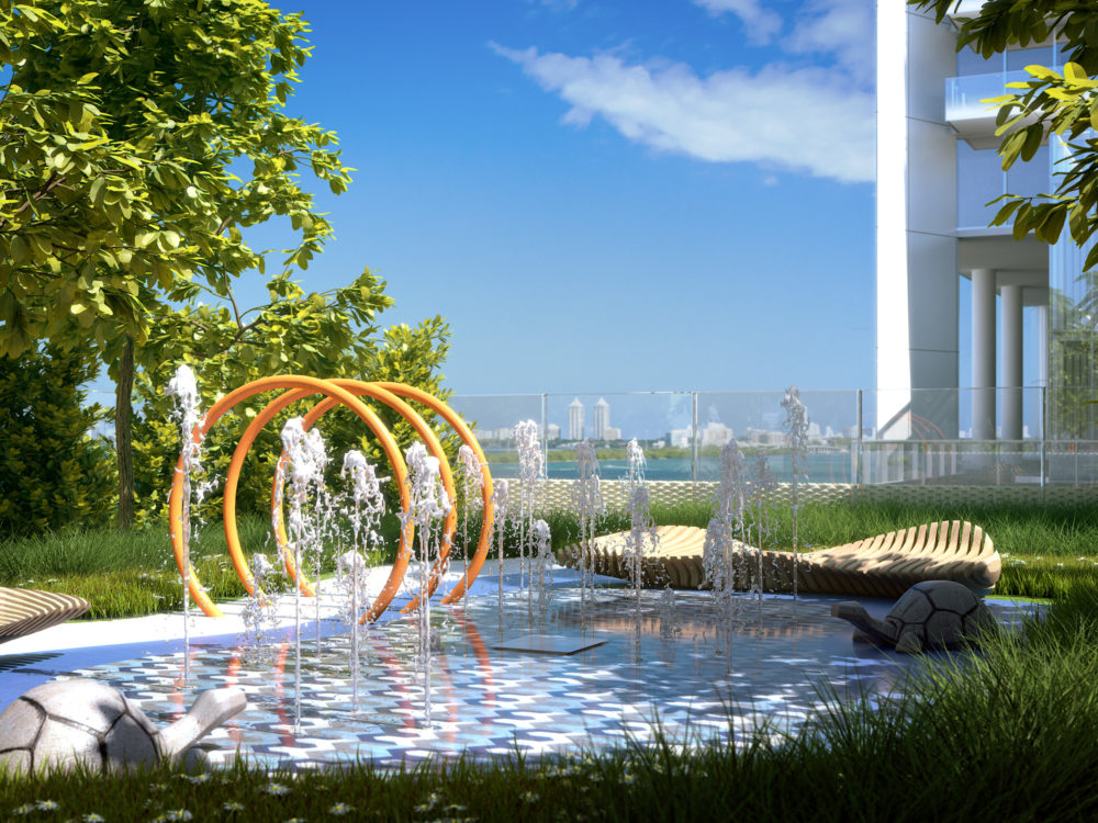 Exterior view of Missoni Baia residence kids waterplay area. Over looks the oceans and has fresh green grass around.
