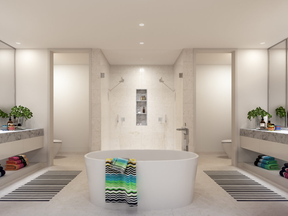 Interior view of Missoni Baia residence bathroom with white soak tub and high pressure showers. Is in Miami with ocean views.