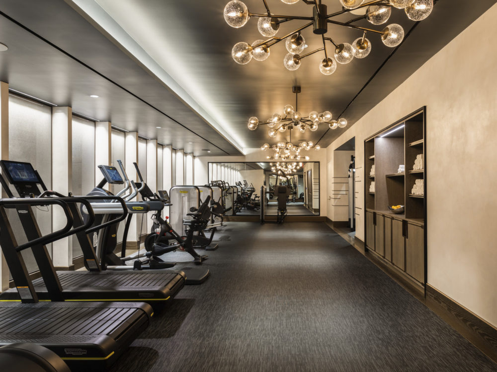 1010 Park Avenue fitness center includes cardio and conditioning equipment and custom wainscoting and textured wall panels.