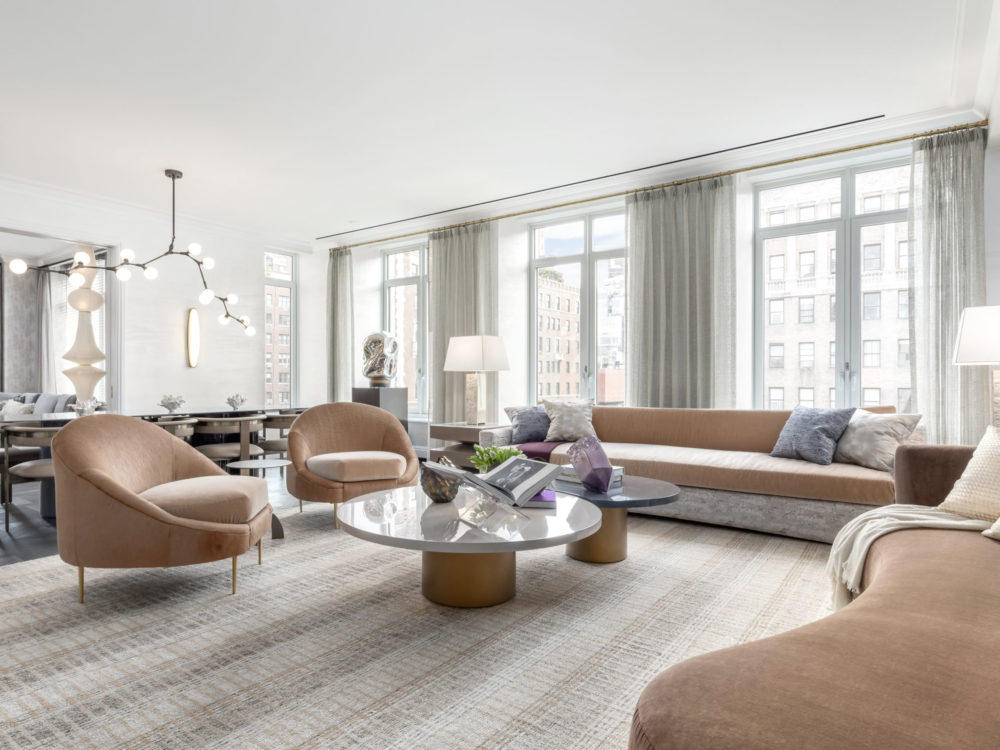 1010 Park Avenue full floor residence great room including Continental Oak Versailles flooring and tan furniture in NYC.
