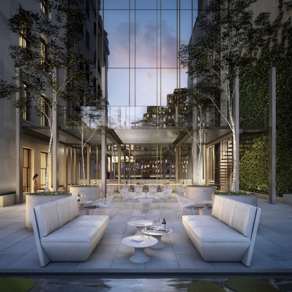 View of outdoor terrace at 111 West 57th street with white furniture to relax or host dinner parties located in NYC.