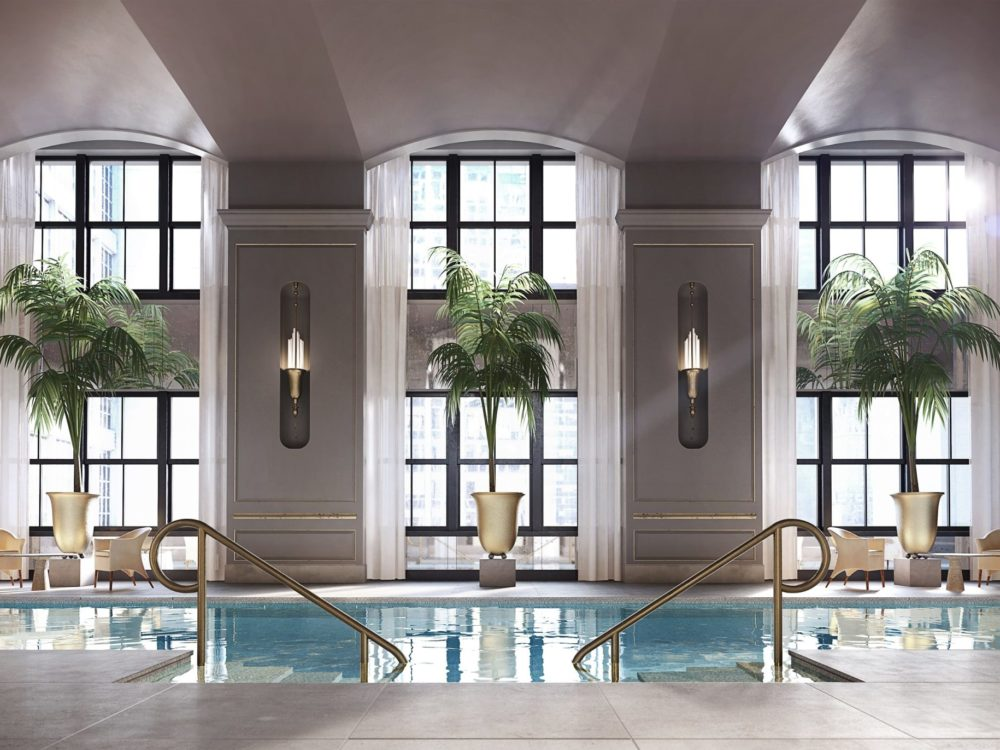 View of 111 West 57th street pool with double-high vaulted ceilings and private cabanas during an New York City morning.