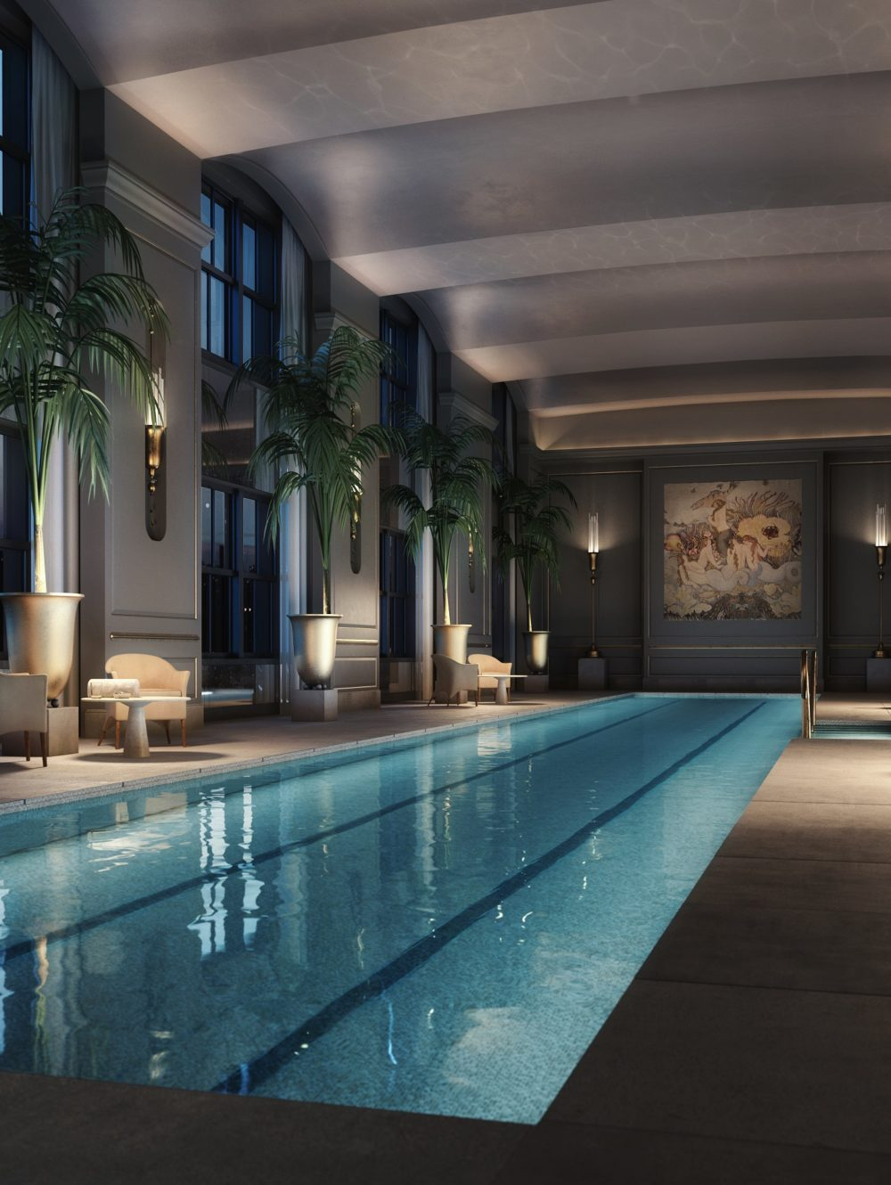 View of 111 West 57th street pool with double-high vaulted ceilings and private cabanas during an New York City evening.