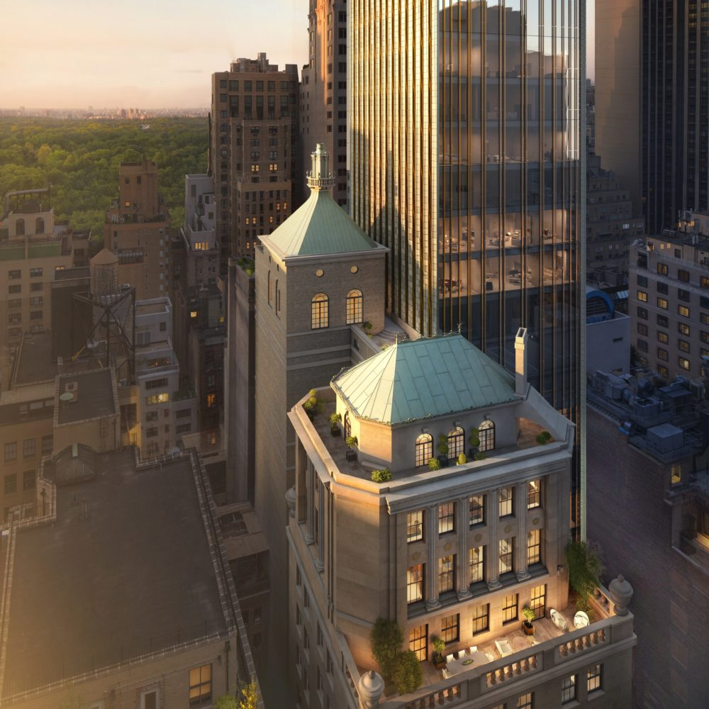 Exterior aerial view of 111 West 57th street looking downward at two buildings with green roof tops in New York City.