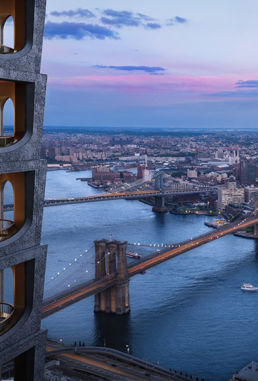 Exterior of 130 William residential condo tower in New York. Side view of condo tower with Brooklyn Bridge in the background.