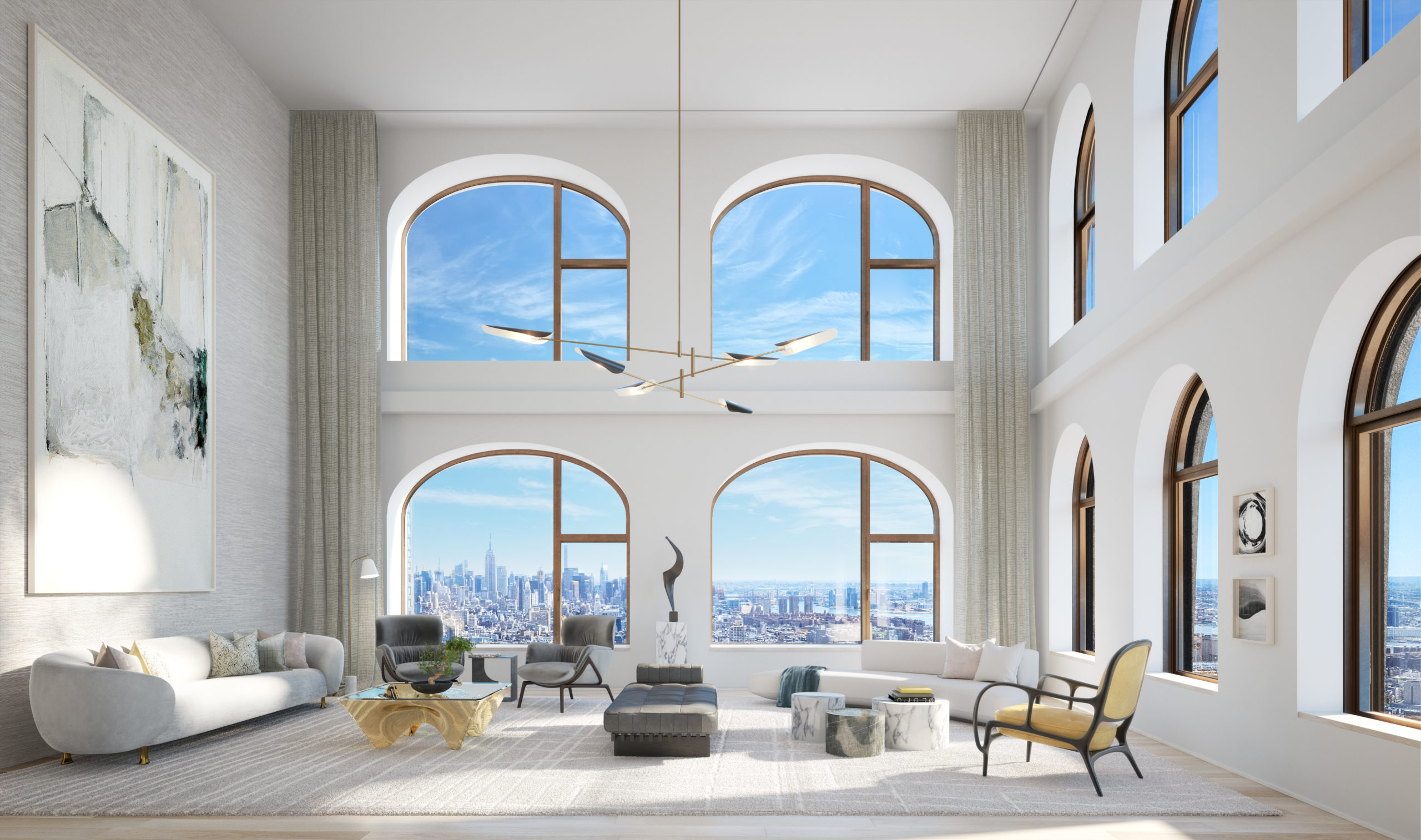 Large living room with high ceilings, white walls, and 10 windows. Interior of 130 Williams condo designed by David Adjaye.